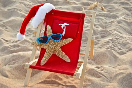 Santa starfish lounging in a beach chair.