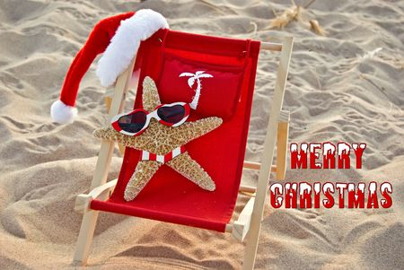 Santa starfish in a beach chair. Reklamní fotografie