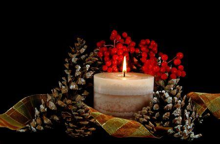 autumn arrangement: Glowing candle in an autumn arrangement. Stock Photo