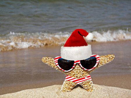 Santa starfish in hat, bikini and sunglasses.