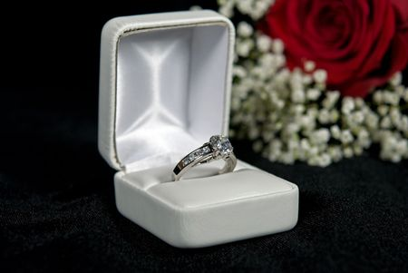 diamond ring: Diamond engagement ring in box with rose. Stock Photo