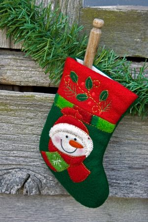 Single Christmas stocking pinned with old clothespin. photo