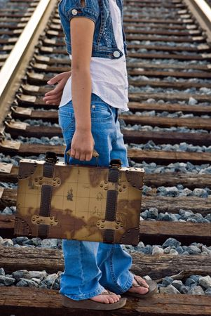vintages: Young girl carrying a vintages suitcase.