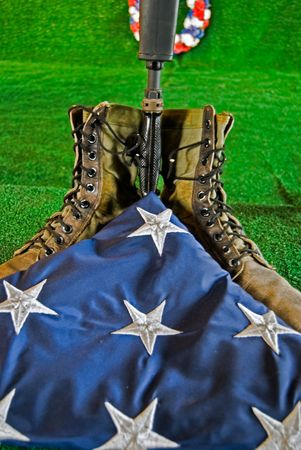 honorable: Military rifle and boots with folded flag.