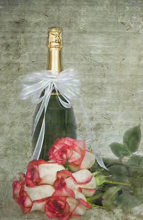 champagne celebration: Wine bottle and rose bouquet with textured effect. Stock Photo