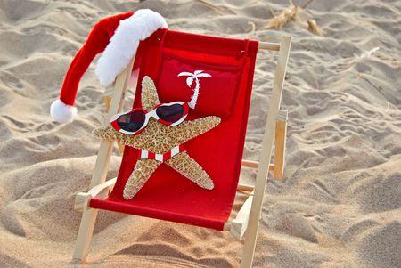 tropical christmas: Christmas starfish in beach chair.