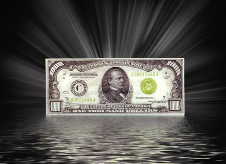 Thousand dollar bill with reflection.
