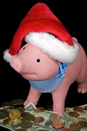Santa hat on a piggy bank. photo