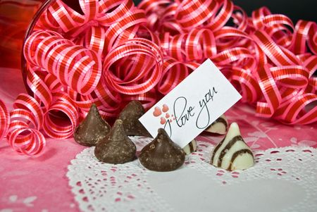 Chocolate candy with love note and ribbons. Stock Photo
