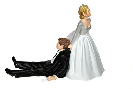 humourous: Bride dragging groom on white background.