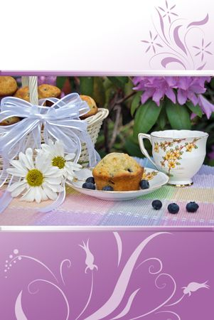 Antique tea set with blueberry muffins in garden.