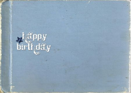 Happy birthday with star on textured background.