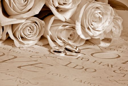 Bridal wedding bouquet with rings in sepia tones. photo