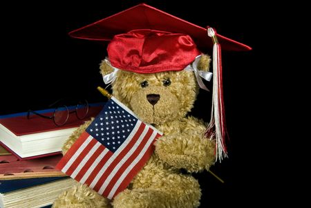 Teddy bear wearing a graduation cap with flag. Stock Photo - 7051264