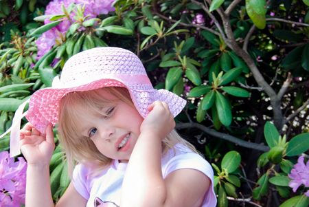 pink hat: Winking little girl in pink hat.