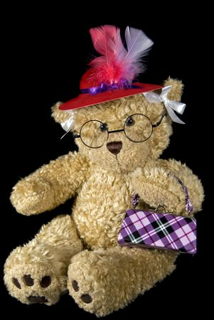 Teddy bear with red hat and purse. Stock Photo - 7102842