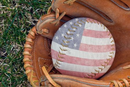 Flag design on softball in glove.