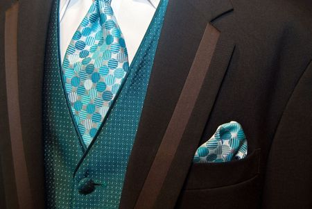 Teal silk tie with brown tuxedo. 스톡 콘텐츠
