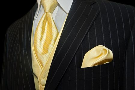 Gold necktie with pinstriped tuxedo. Stock Photo