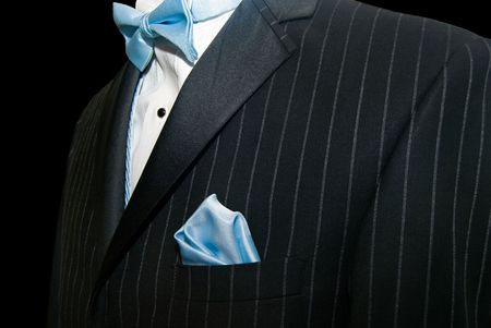 Blue bow tie with pinstriped tuxedo. photo