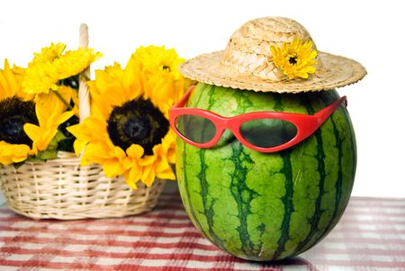 humor: Sunglasses on a watermelon with sunflower bouquet.
