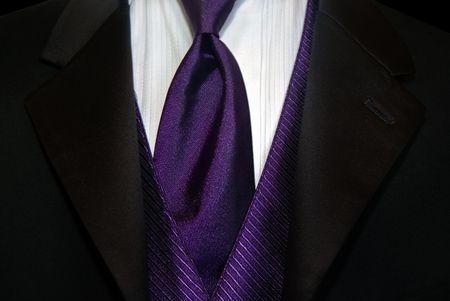 Purple necktie with black tuxedo. photo