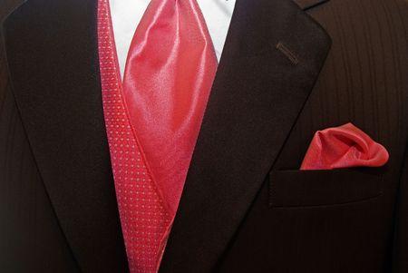 Bright colored accessories accenting a brown tuxedo. photo