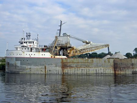Old freighter unloading coal. photo