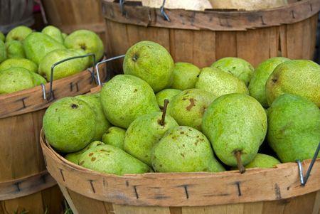 bushel: Fresh picked pears in bushel baskets. Stock Photo