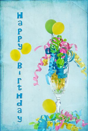 Happy birthday crystal flute with balloons and ribbon. Stock Photo - 8080034