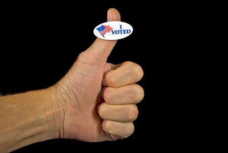 man's thumb: Voting sticker on a mans thumb.