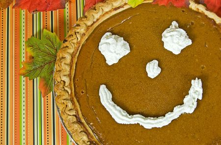 Pumpkin pie with a happy face.