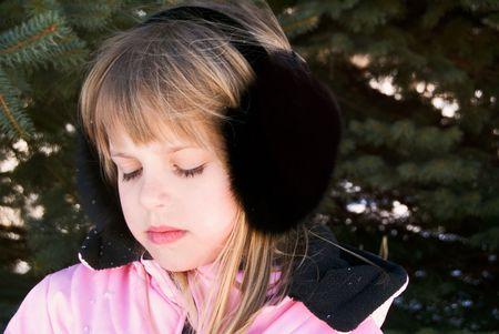 ear muffs: Young girl wearing black fox ear muffs.