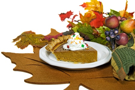 Pumpkin pie on a leaf place mat. Stock Photo - 8295145