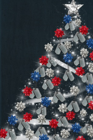 Military dog tags with bows on Christmas tree.