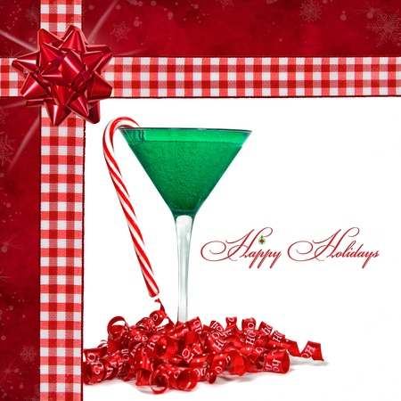 Candy cane with holiday drink in gingham frame. Фото со стока