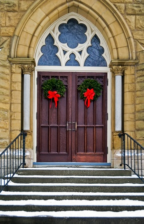 religious building: Christmas wreaths on cathedral doors.
