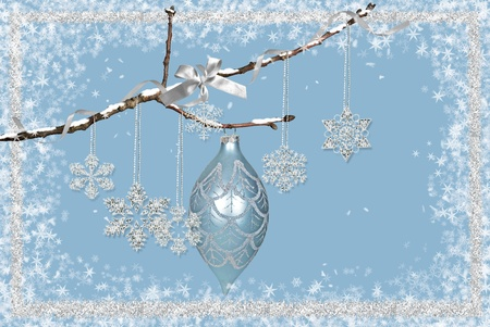 silver frame: Holiday ornament and snowflakes hanging from twig.