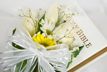 Spring wedding bouquet on Holy Bible.