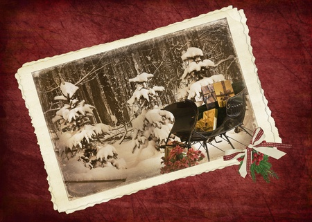 vintage photo: Vintage sleigh with Christmas gifts in snapshot frame.