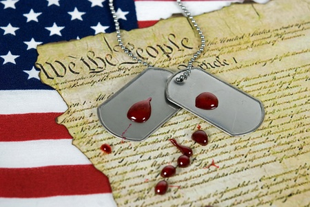 Drops of blood on military dog tags. photo