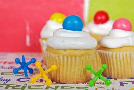 jacks: Toy jacks with party cupcakes. Stock Photo