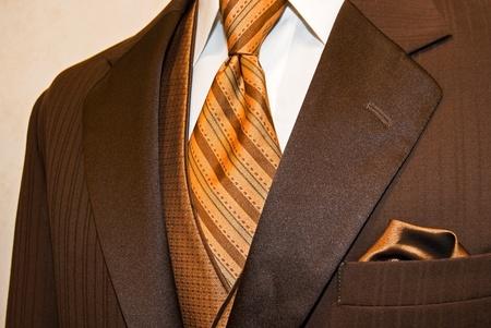 Rich brown tuxedo with bronze accessories. photo