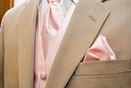 Pink accessories with light tan tuxedo.l photo