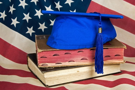 Flag background with graduation hat on books.