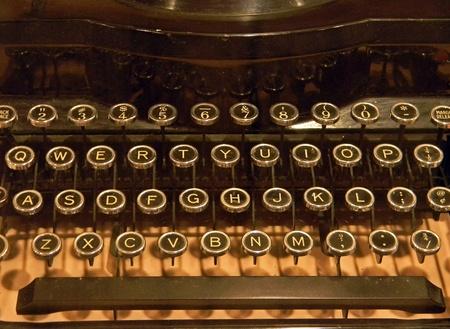 nostalgic:   Close of old-fashioned typewriter in sepia tones.
