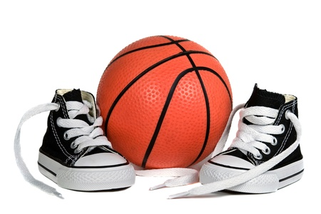 untied: Pair of sneakers with basketball on a white background. Stock Photo