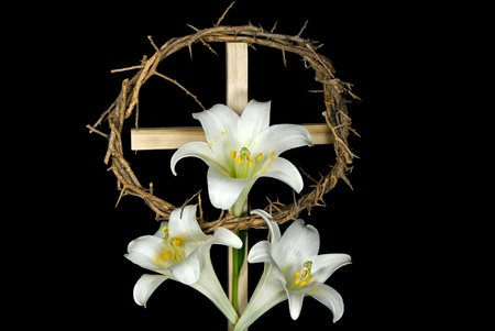 easter sign: Crown of thorns with Easter liles on cross.