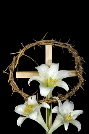 Crown of thorns and Easter lily on cross. Stock Photo
