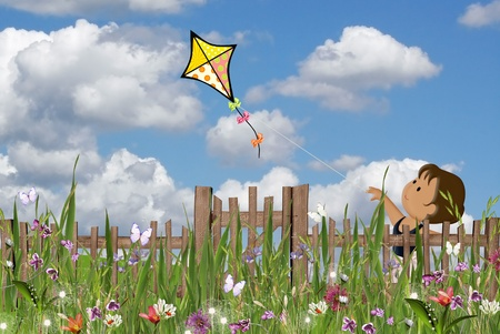 Little girl flying a kite in summer garden. Stock Photo